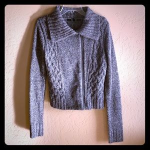 Grey cable knit zip front jacket.